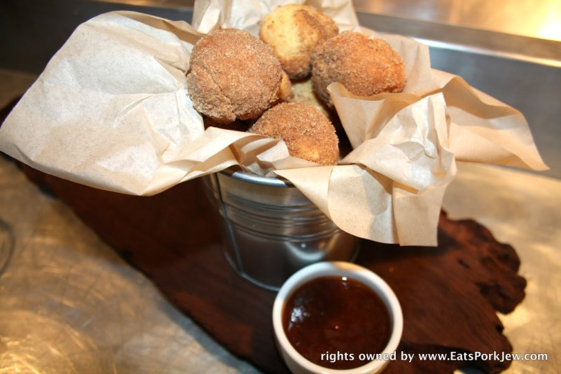 doughnuts at Backyard restaurant with cinnamon and sugar and plum jam