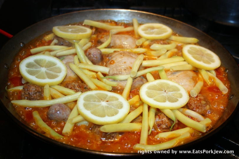 Spanish Paella with wax beans and lemon slices