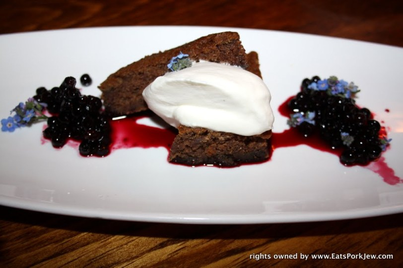 Candy cap mushroom and date cake with huckleberries.