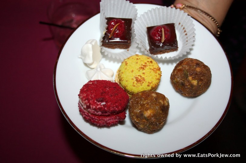 French Macaroons (pistachio and raspberry), date balls, flourless chocolate cakes with fruit preserves on top, and baked meringues
