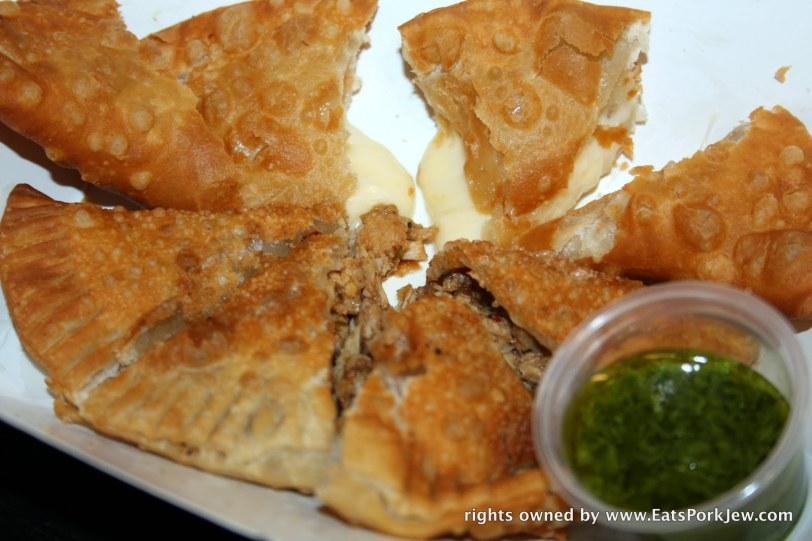 one plain cheese and one with jerk chicken from DC Empanadas at DC's Union Market