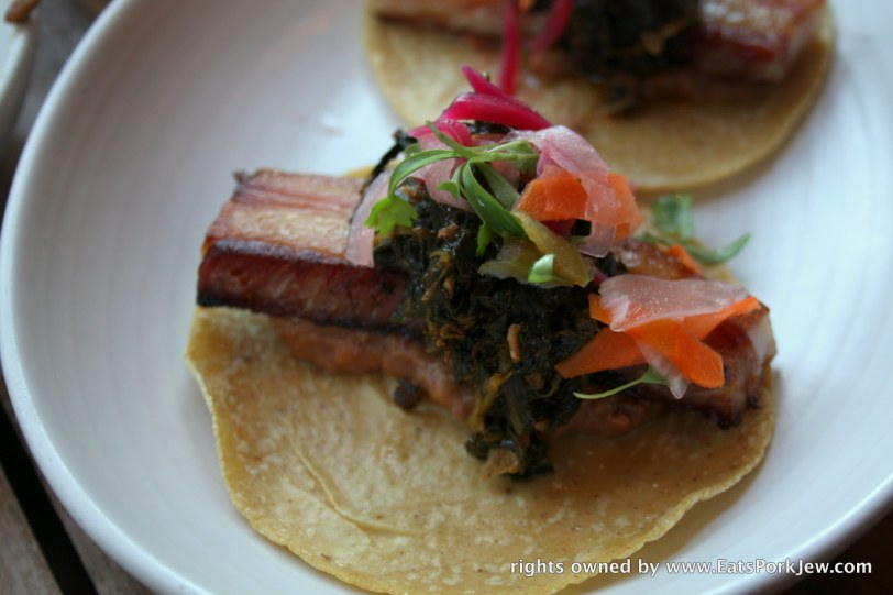 Braised Pork Belly tacos with smashed chorizo beans, morita braised greens and jalapeno escabeche from Padrecito an upscale Mexican restaurant in San Francisco