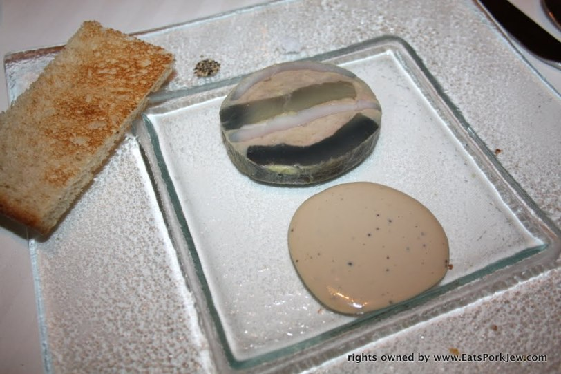 A terrine from Guy Savoy in Las Vegas at Caesars Palace, which was a Mosaic of milk-fed poularde, foie gras, artichoke, and black truffle jus