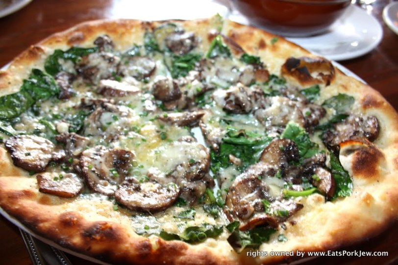 Crimini mushroom flatbread with savoy spinach and Tartufello; a sheep's milk pecorino like cheese imported from Tuscany from  A Coté in Oakland's Rockridge District #2