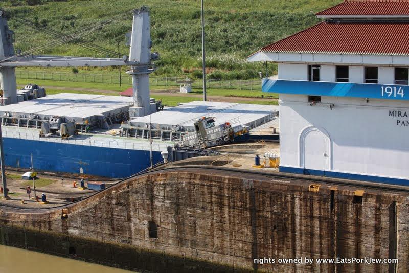 day-trip-to-panama-canal-towing-boats-miraflores-locks
